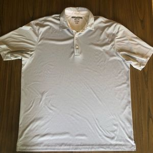 Greg Norman play dry golf polo